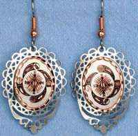 Unique handcrafted earrings, cut out silver bezel embellished with copper Native American copper artwork