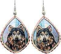 Timber wolf earrings handmade from copper with blue background