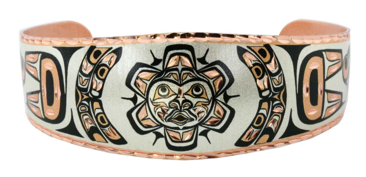 Make a bold style statement by wearing this fascinating Native Haida sun totem bracelet